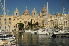 Motor cruisers and yachts in Vittoriosa, Malta. Motor cruisers and yachts in Vittoriosa. Mediterranean island of Malta Stock Image