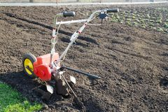 Motor cultivator for the spring plowing. The concept of gardening, gardening, farming, environmentally friendly food.  Royalty Free Stock Image