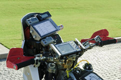 Motor Cycle Navigation Instruments. The image illustrates the vast amount of navigation and safety equipment required by a enduro off road motor cycle racer Stock Image