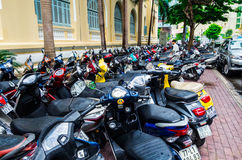 Motor cycles and scooters on a Ho Chi Minh City sidewalk Stock Photos