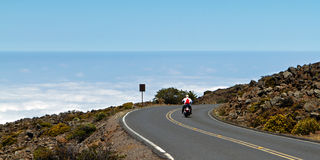 Motor cyclist above the clouds Royalty Free Stock Photography
