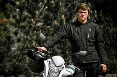 Motor cyclist in forest Stock Images