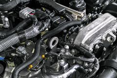 Motor de automóveis Peça do motor de automóveis Imagem do close-up motor a combustão interna Motor que detalha em um carro novo D imagens de stock