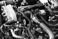 Motor de gasolina do carro Peça do motor de automóveis Imagem do close-up motor a combustão interna Motor que detalha em um carro fotografia de stock royalty free