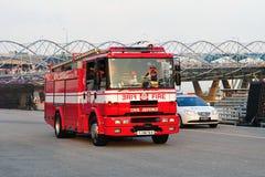 Motor de incêndio e carro de polícia em NDP 2011 Foto de Stock Royalty Free