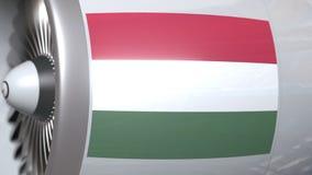 Motor del aeroplano con la bandera de Hungría Animación conceptual 3D del transporte aéreo húngaro almacen de video