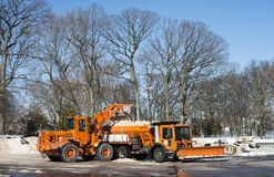 Motor e snowplow da terra Fotografia de Stock