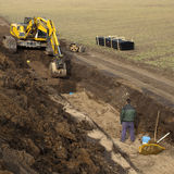 Motor e trabalhador da terra Fotos de Stock