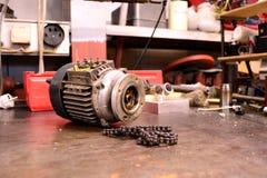 Motor eléctrico y encadenamiento Foto de archivo