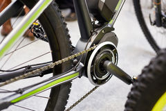 Motor electric bicycles in front of carriage pedals Stock Photos