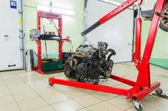 Motor engine on elevator in car service station Stock Photos