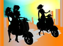 Motor Exploration. Silhouettes about Model riding Vespa around the City Royalty Free Stock Photography