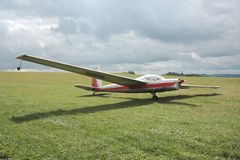 Motor glider. On the green runway at storm Royalty Free Stock Photos