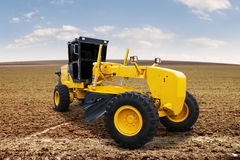 Motor grader on the road construction Royalty Free Stock Image