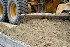 Motor Grader Shoveling Earth Royalty Free Stock Images