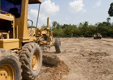 Motor grader working on road construction Stock Images