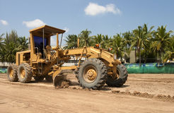 Motor grader working on road construction Royalty Free Stock Photography