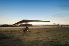 The motor hang-glider. On the runway at sunset Stock Photography