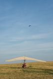 The motor hang-glider. On the runway at sunset and parachutist Stock Image