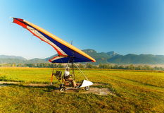 Motor hang glider close up, on the ground and man. Stock Photography
