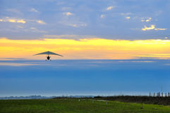 Motor hang glider in the cloudy sunset Stock Images
