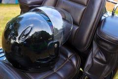 Motor helmet. Black helmet on a leather seat motors, photography Royalty Free Stock Photos