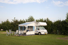 Motor home. Parked at a camping in the Netherlands Stock Photos