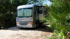 Motor home on camp site Royalty Free Stock Photo