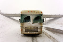 A motor-home covered with snow in white-out conditions Stock Photo