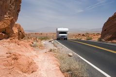 Motor Home in the Desert. A motor home driving down a desert highway in the southwest U.S Royalty Free Stock Photos