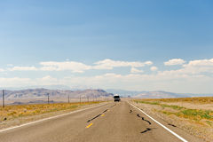 Motor home on desert highway Stock Photo