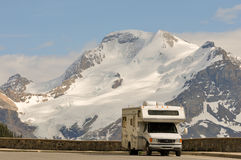 Motor home near glacier Stock Photos