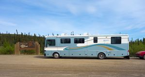 A motor home parked at the beginning of the road leading to prudhoe bay stock photography