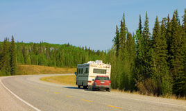 A motor home and tow car in the yukon territories Stock Images