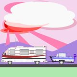 Motor home towing boat at sunset Stock Image