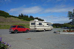 A motor home towing a car in alaska Royalty Free Stock Photography