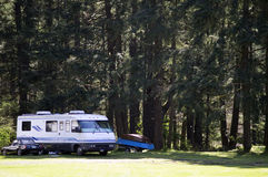 Motor Home Vintage Car boats. Motor Home, Vintage Car and boats on a trailer in a forest campgrounds in Tacoma, Washington on McCord Airfield stock images