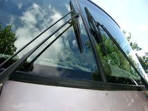 Motor home windshield. Reflection in a motor home windshield with cat inside Stock Image