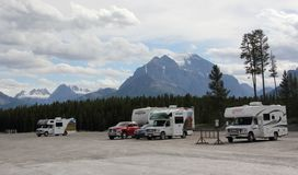 Motor Homes against Rocky Mountains Royalty Free Stock Images