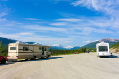 Motor homes at a rest area in the yukon territories. Traveling vehicles parked at a pull-out along the alaska highway stock photo