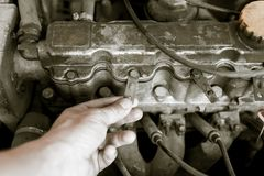 Motor and hoses under the hood of car.  Stock Photos