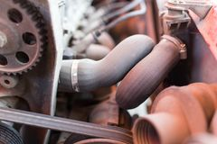 Motor and hoses under the hood of car.  Royalty Free Stock Photography