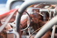 Motor and hoses under the hood of car Royalty Free Stock Photos