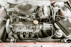 Motor and hoses under the hood of car.  Royalty Free Stock Photos
