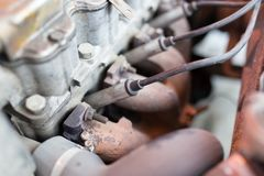 Motor and hoses under the hood of car.  Stock Image