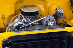 Motor in a hot rod muscle car. Motor in a customized hot rod show car Stock Photo