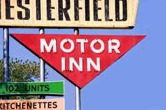 Motor Inn. This is a retro sign for an old motor inn hotel motel against a blue sky Stock Photography