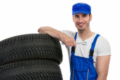 Motor mechanic changes a tyre Stock Image