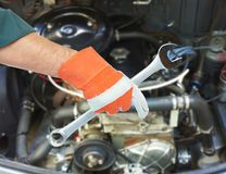 Motor mechanic and spanner Royalty Free Stock Photo