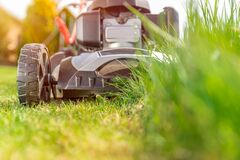 Free Motor Mower To Mow The Lawn Next To The Family House Stock Photography - 183199282